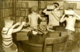Boys Viewing Stereoscopes at the Parish Library