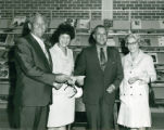 Mayor Dumas recieving a Donation for the Library