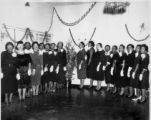 Group of Women in front of Christmas Decorations